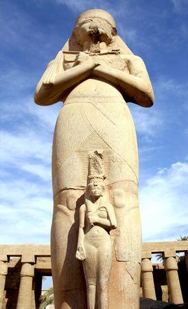 Ramses II statue and Nefertari in Karnak temple Stock Photo