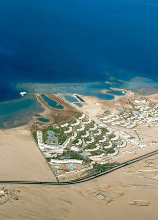 A kind is from above on transparent turquoise waters of Red sea and complexes of hotels Hurghada photo