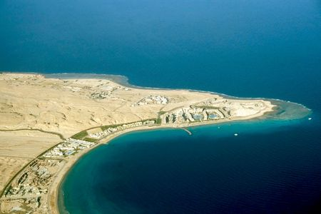hurghada: A kind is from above on transparent turquoise waters of Red sea and complexes of hotels Hurghada Stock Photo