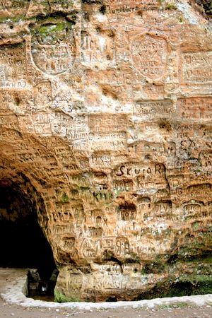 sigulda: Signs on the wall at Gutmana cave in Turaida, Latvia Stock Photo