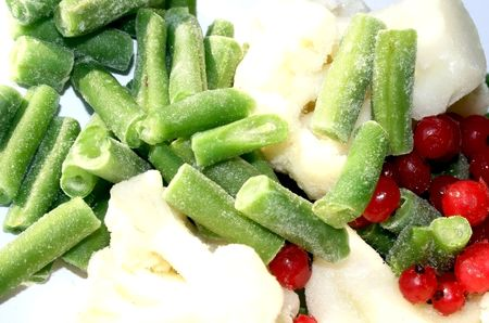 Assortment from frozen cauliflower, green bean and red currant Stock Photo