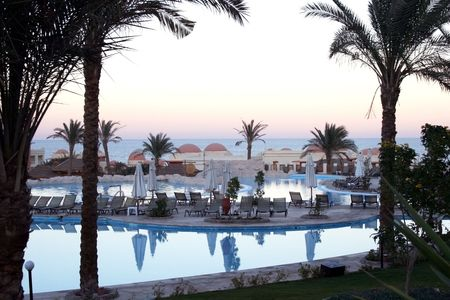 Hotel in moroccan style in Egypt, with swimming-pools on sunset