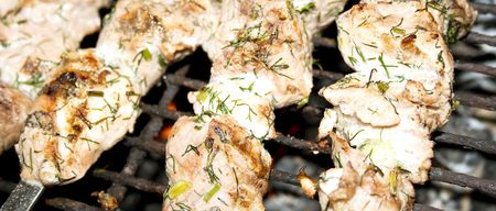 broil: Pieces of appetizing meat broil on a grate