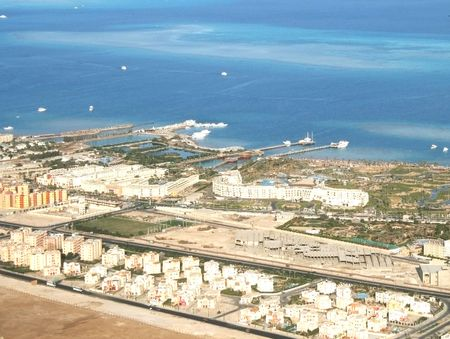 A kind is from above on transparent turquoise waters of Red sea and complexes of hotels Sharm-el-Sheikh photo