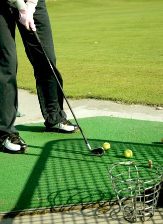 A golf club (driver) about to strike a golf ball on a tee Stock Photo - 5039401