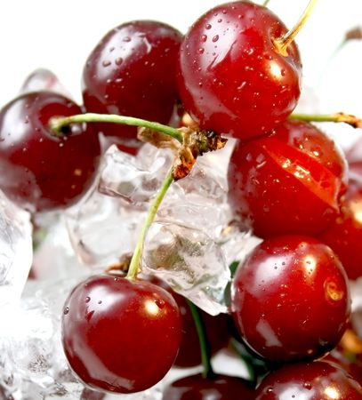Fresh cherry closeup with drops of water in ice Stock Photo