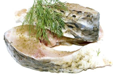 A la carte fresh pieces of carp with seasoning and dill photo