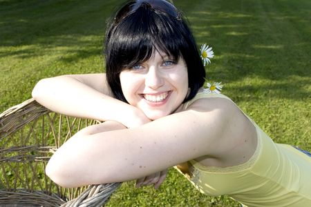 Smilling sexy brunette relaxing to meadows Stock Photo - 5157565