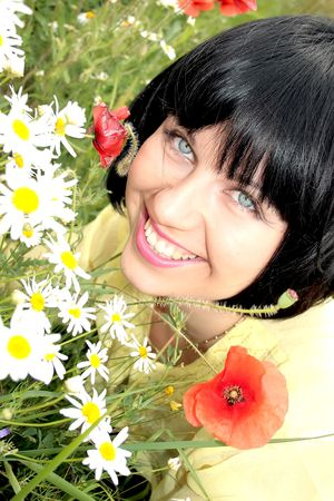 Beautiful lady in the flowers summers photo