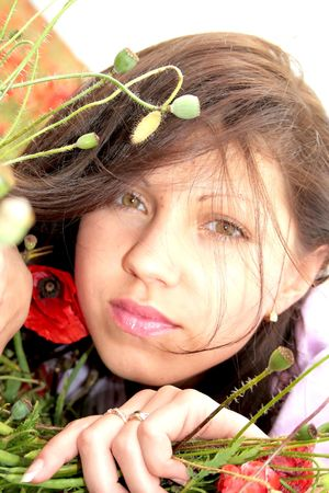 Attractive girl is in the poppy field photo