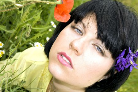 Beautiful passionate lady in the flowers summers photo