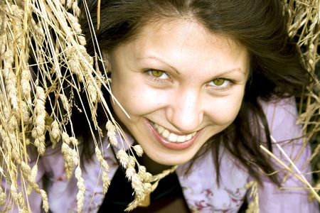 smilling: Smilling young brunette in a haystack
