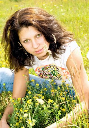 Attractive brunette on summer a meadow Stock Photo - 5208907