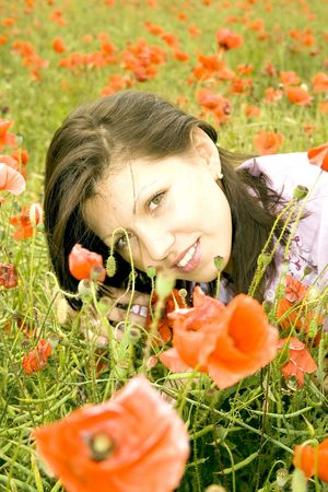 smilling: Beautiful smilling brunette among red poppies