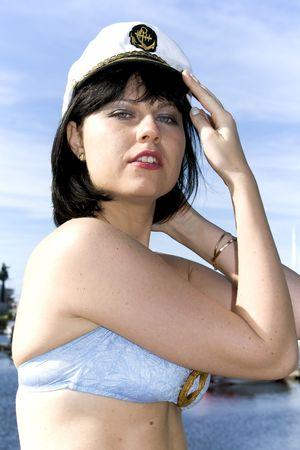 Pretty brunette in a marine cap photo