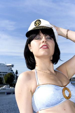Pretty brunette on background of big cruise liner photo