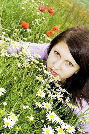 Beautiful lady among the flowers meadows photo