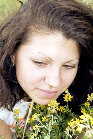 smells: Young attractive brunette on summer a meadow