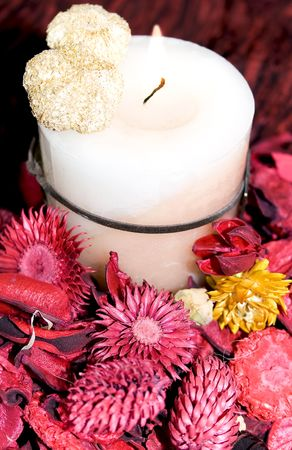 Christmas decoration with candle and  dry flowers  red and yellow photo
