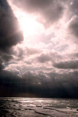 shaft: Beams of sunlight push through the clouds on the Mediterranean sea