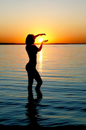 Silhouette of girl on sunset in the Baltic sea photo