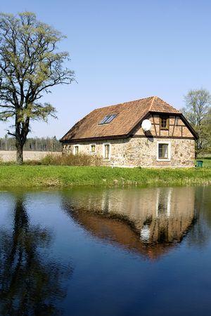 ashore: Rural stone cottage ashore lake Stock Photo