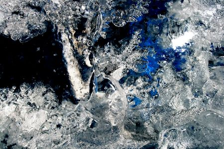Blue melting ice texture closeup photo