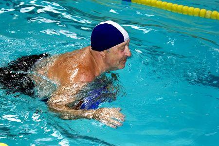Active happy senior  in swimming-pool