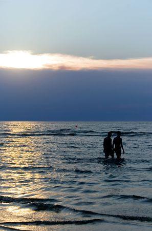 Two silhouettes ashore the Baltic sea photo