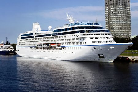 The big cruise liner near to embankment in port Riga photo