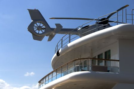 Helicopter sitting on the deck of a private yacht