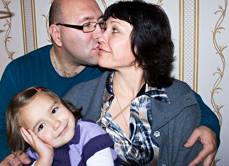 Happy loving couple and smiling daughter Stock Photo