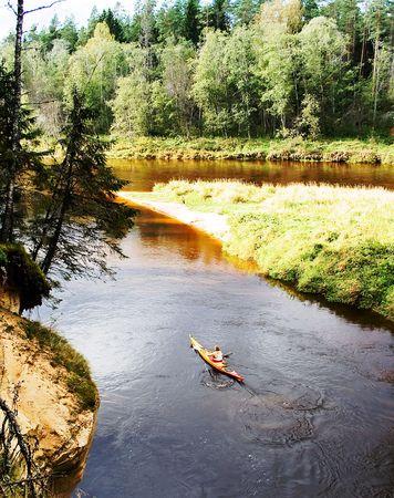 Trip on kayak to down the river Gauja on national park Ligatne, Latvia