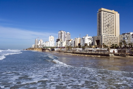 Sea coast and panorama of new modern built city Bat-Yam, Israel photo