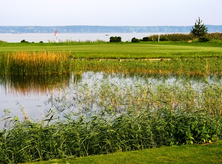 Field for golf with a small lake in Riga, Latvia photo