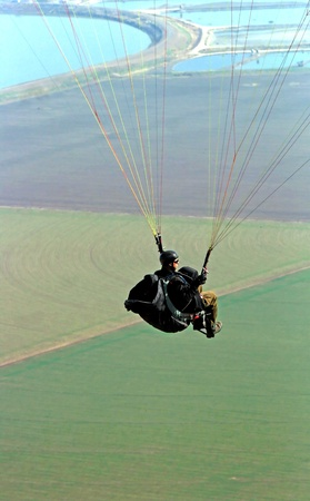 Paraglider flying from the Gilboa mountains, Israel photo