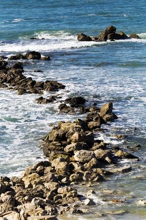 yam israel: The winter Mediterranean sea. Coastal rocks on quay Bat-Yam