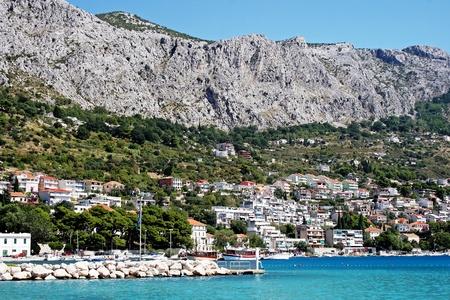 Croatian town Omis ashore the Adriatic sea photo
