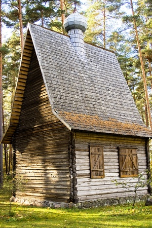 Old wooden church on territory Latvian Ethnographic museum under opened founded sky in 1924 and 97 ga occupies territory ashore lake Yugla Stock Photo - 11193944