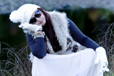 ashore: Beautiful woman in Christmas style - in white knitted cap and mittens ashore forest lake Stock Photo
