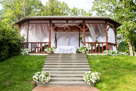 Wooden arbour for realization of wedding ceremonies Stock Photo
