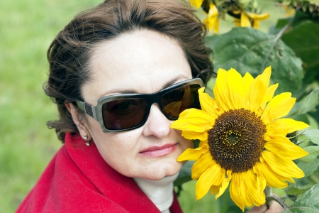 Portrait of lady in red with a sunflower photo