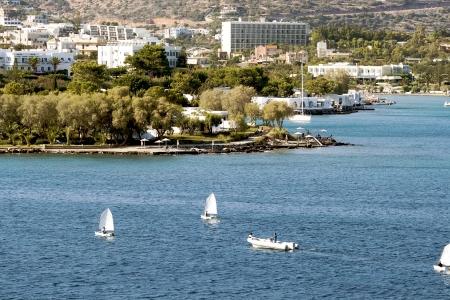 ashore: Aghios Nikolaos city at Crete island ashore Aegean sea in Greece Stock Photo