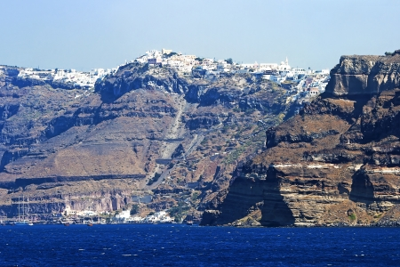Panoramic view of Santorinis city of Fira hanging on the volcanic caldera at Santorini island in Aegean sea, Greece photo