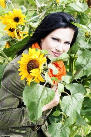 amongst: Portrait pretty brunette amongst sunflowers Stock Photo