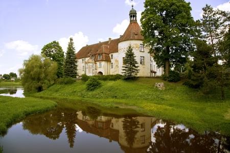 Ancient medieval castle of the XIV century Jaunpils, Latvia Stock Photo