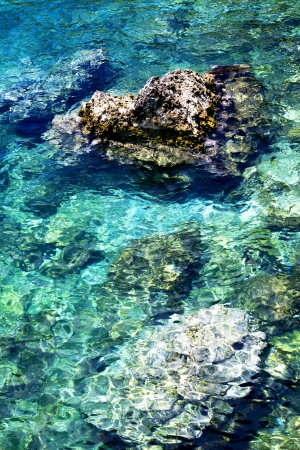 Clear turquoise water ashore the Adriatic sea in Budva, Montenegro Stock Photo