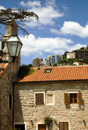 View with old medieval stone houses and modern buildings in Budva, Montenegro photo