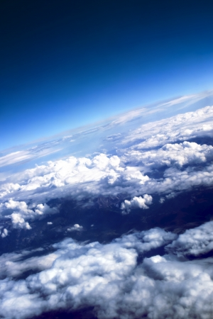 spacial: Puffy clouds with the brightly expressed atmosphere on height of 10 000 m above planet Earth