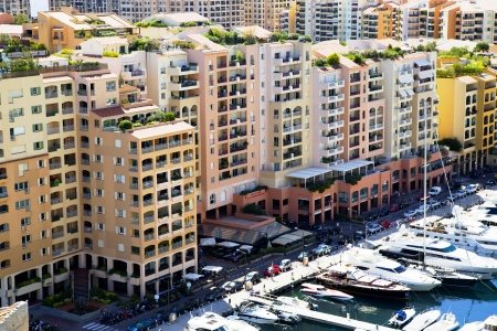 Fontvieille harbour with modern building architecture and luxury yachts on a background Seashore Alps 25 08 2013